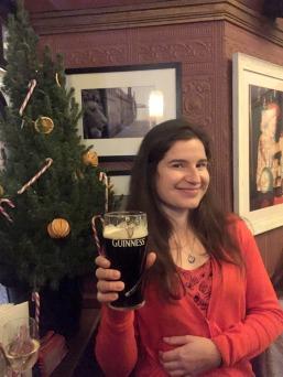 Monika enjoys a pint of Guinness at the Morpeth Arms pub. Photo credit Kelise Franclemont.