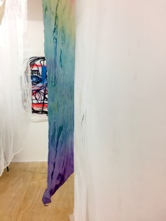 "(background) Drawing by Monika Krasoń. (foreground) ""Maze of Fabrics"" by Alex Roberts, Karina Kaluza, and Monika Mysiak."