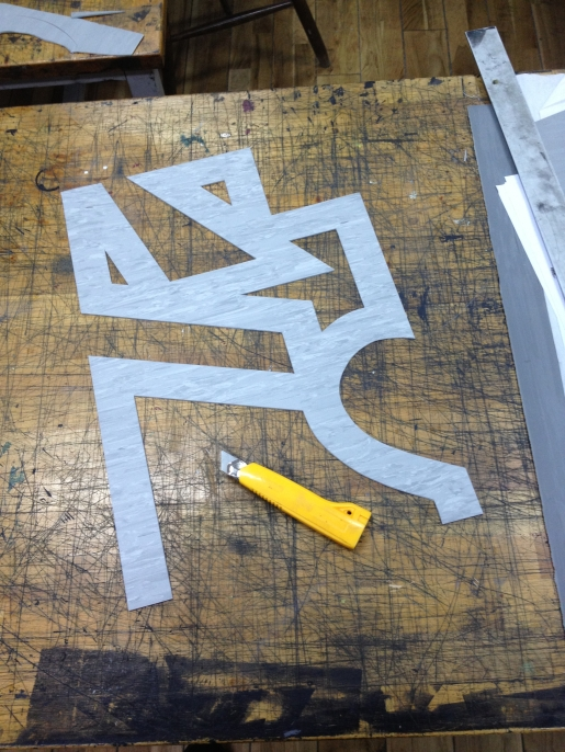 Jonathan makes a linocut to define a new language symbol using only the diacritical marks in Polish language. Image courtesy the artists.
