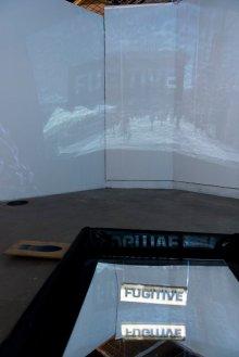 Wojtek Kazimierczak and Marilyn Collins. 'Fugitive', 2016/17, projected video, stencil device, and reflecting pool in 'Connect: Katowice and London' at Rondo Sztuki Gallery, Katowice, Poland. Image courtesy Rondo Gallery and Connect: Art Projects. Photo credit Michał Jędrzejowski.